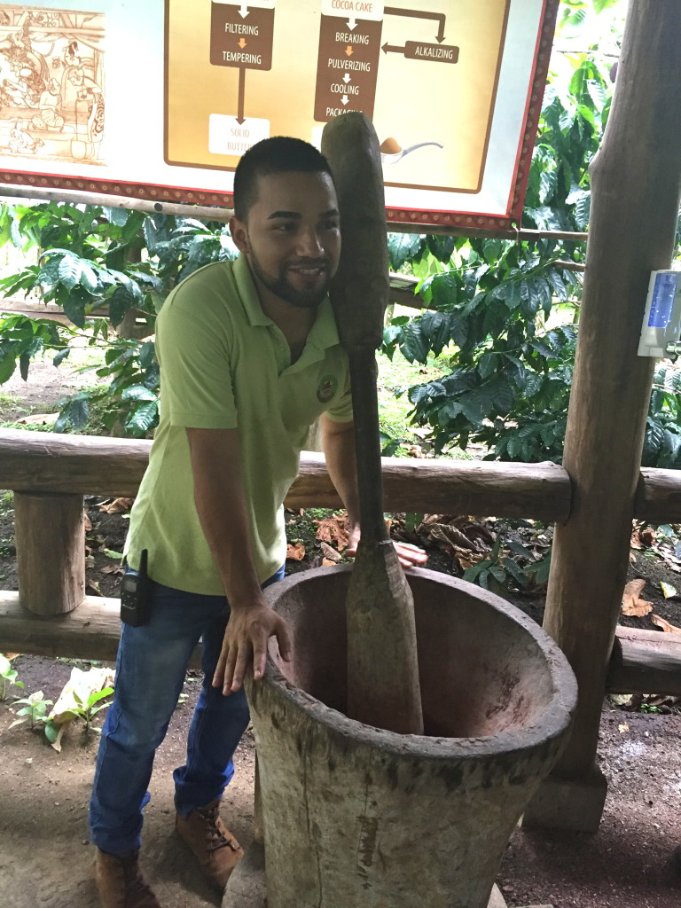 Andrei with a giant pilón, (mortar and pestle) used to smash up the cocoa seeds.